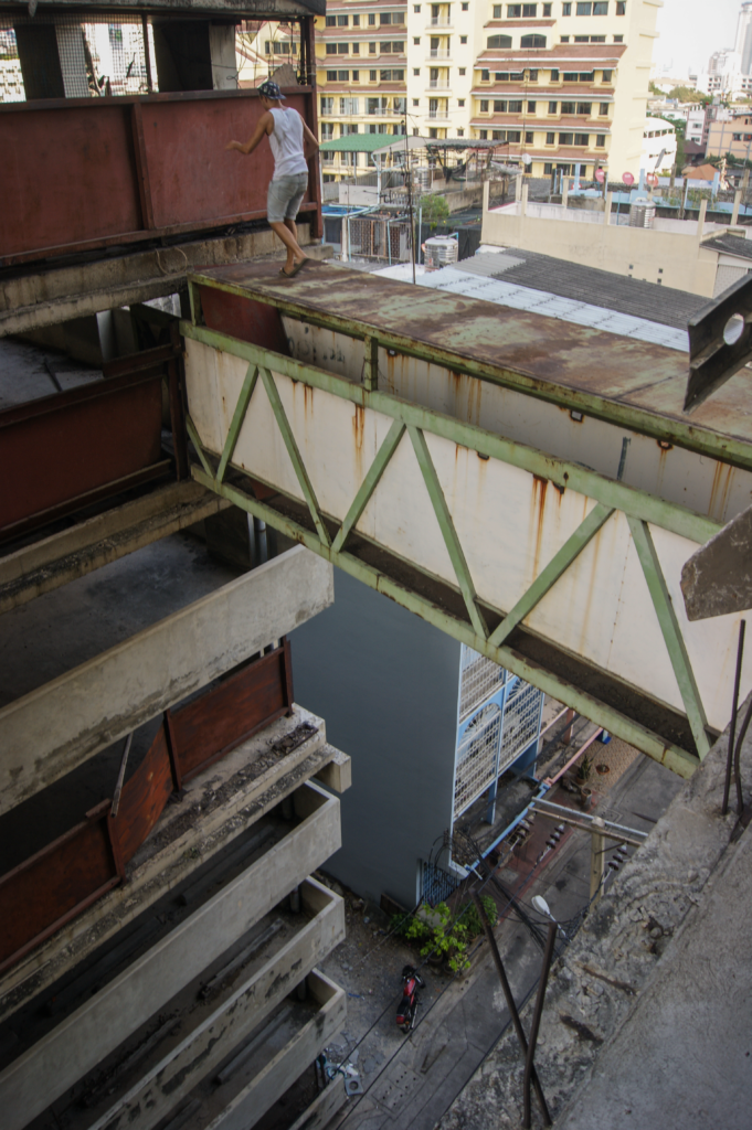 Rusty bridge without railing high above the ground